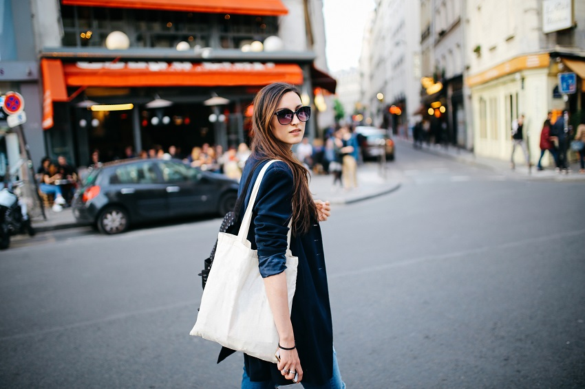 young tourist woman with designer bag